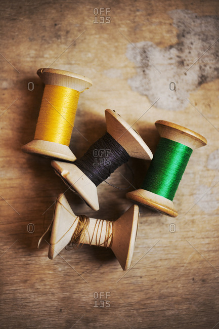 Bobbins of wound thread, silks and cottons in bright colors