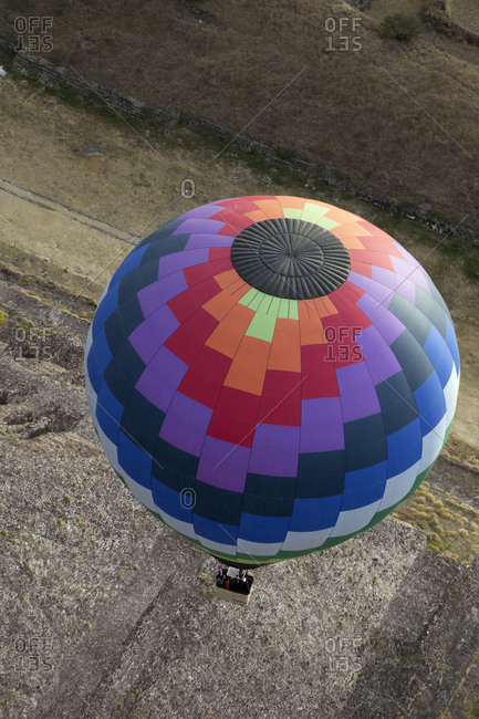 A hot air balloon in flight seen from above