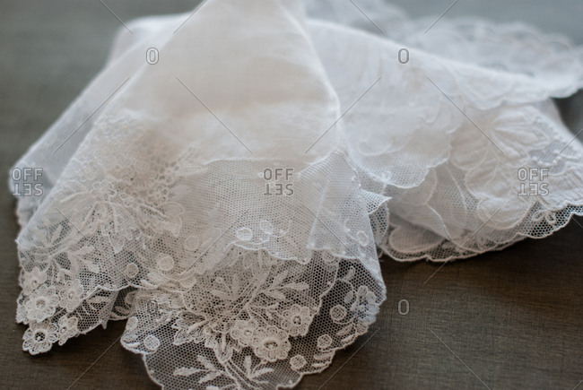 Piece of lace on gray background