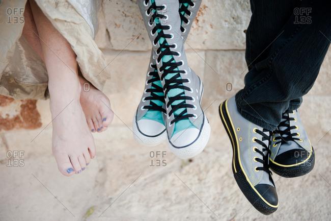 Three people with various footwear