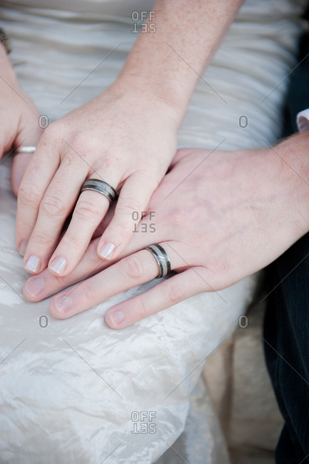 Wedding rings on bride and groom's hands