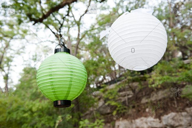 Japanese lanterns by a hill