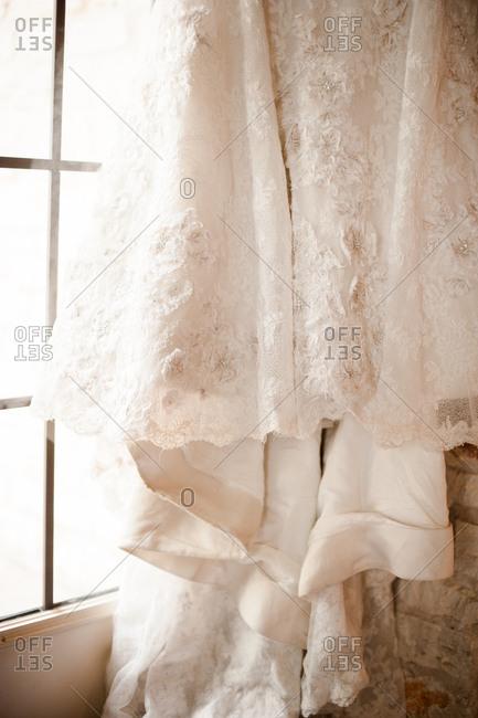 Hem of a bridal gown in window