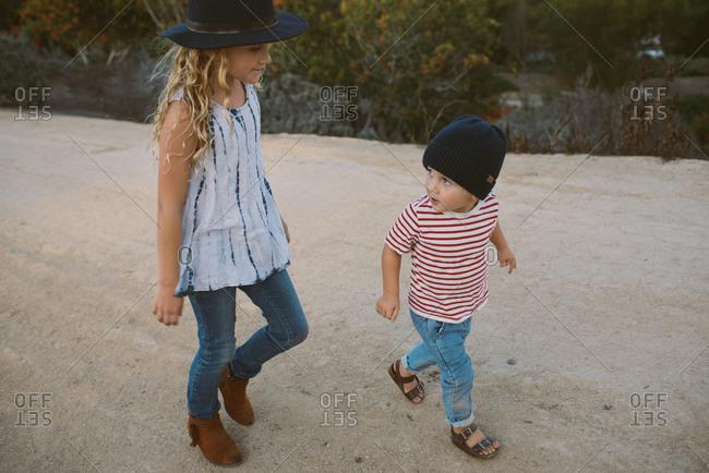 Two walking in rural area