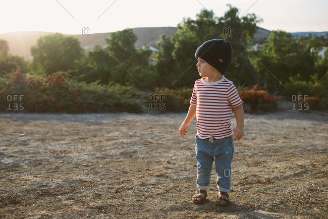 Boy exploring rural area at sunset
