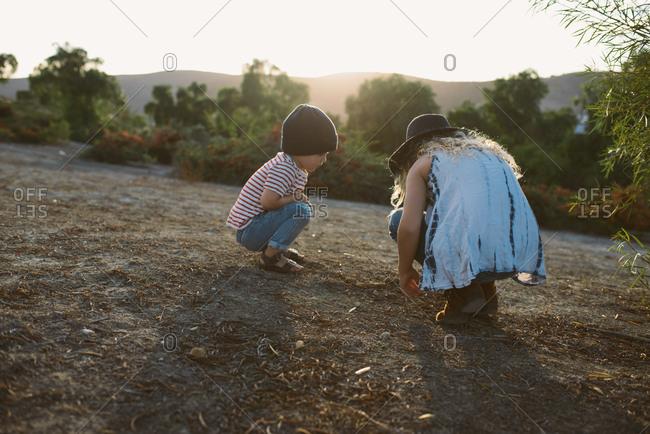 Kids exploring hills at sunset