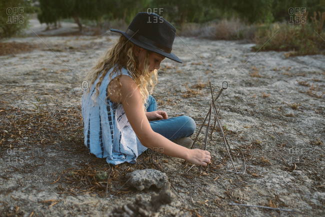 Young girl playing with sticks
