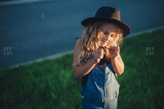 Girl picking flowers in sunset