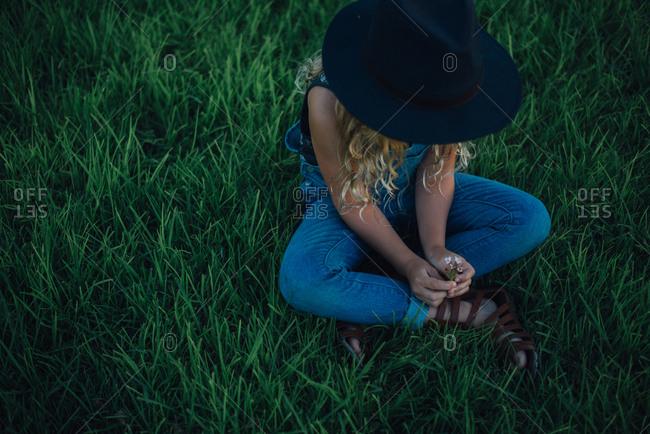 Girl admiring small wild flowers