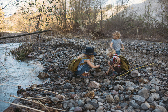 Kids exploring rural area by river