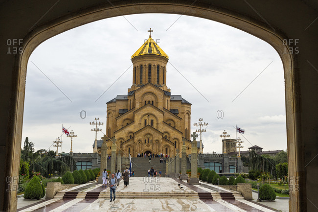 Tbilisi, Georgia - September 16, 2016: Holy Trinity Cathedral viewed through arches, Tbilisi, Georgia, Caucasus, Asia