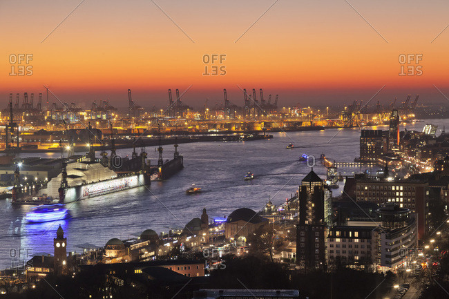 Hamburg, Germany - December 29, 2016: View over St. Pauli district and St. Pauli Landungsbruecken pier over the harbor at sunset, Hamburg, Hanseatic City, Germany, Europe