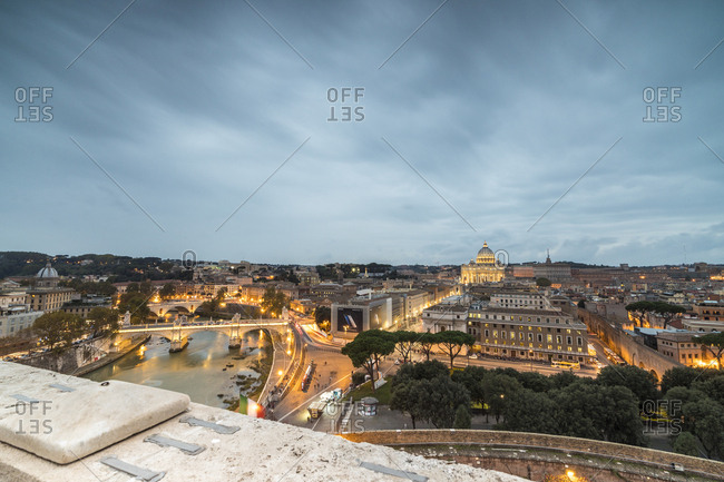 Rome, Italy - November 5, 2016: Dusk lights on Lungo Tevere with the Basilica di San Pietro in the background, Rome, Lazio, Italy, Europe