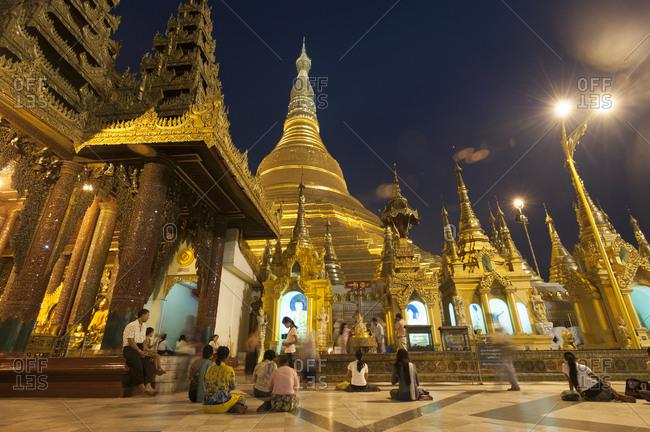 Yangon, Myanmar - March 13, 2010: Devotees come to pray at Shwedagon Pagoda, Yangon (Rangoon), Myanmar (Burma), Asia