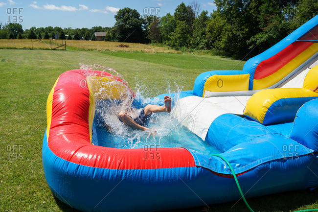 man playing on inflatable water slide