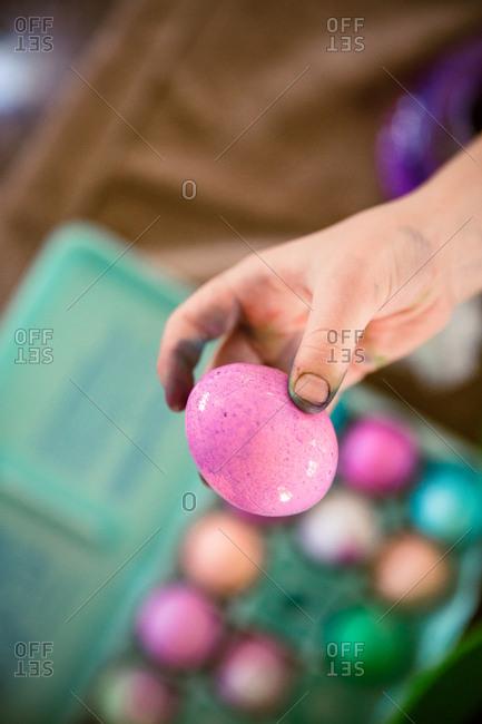 Child's hand holding Easter egg