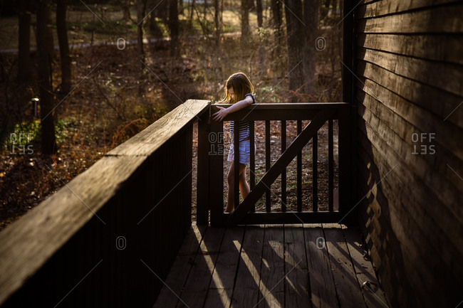 Girl opening a gate