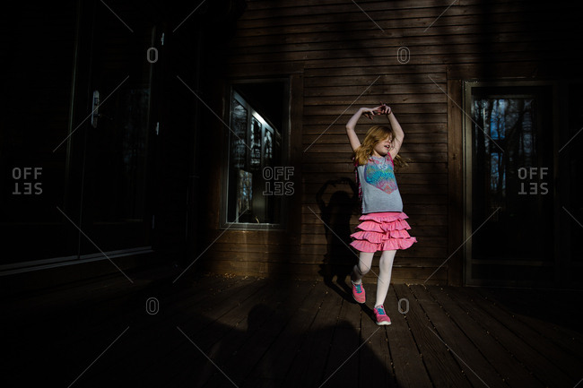 Young girl dancing on deck