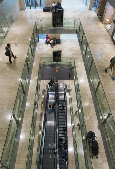 January 2, 2017 - Melbourne, Australia: Shoppers on escalator in multistoried mall