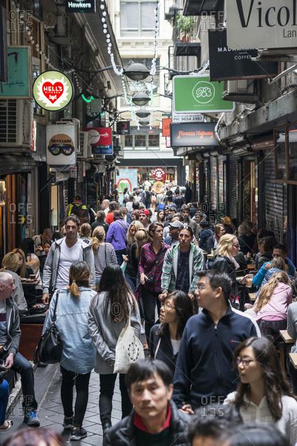 January 2, 2017 - Melbourne, Australia: People walking down a busy side street