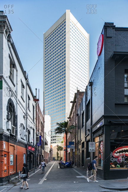 January 5, 2017 - Melbourne, Australia: Street with historic buildings opening onto a modern skyscraper