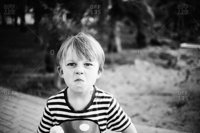 Young boy making a mad facial expression