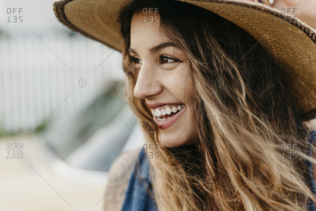 A girl laughing with a hat on
