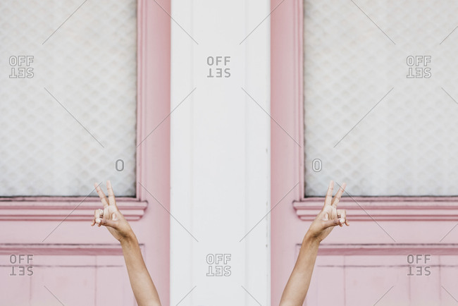 Peace Signs over Pink Doors