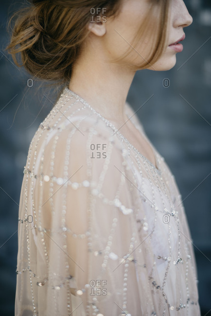 Side profile of a woman in a romantic top