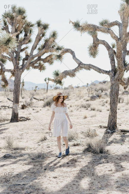 A portrait of a girl walking in the desert