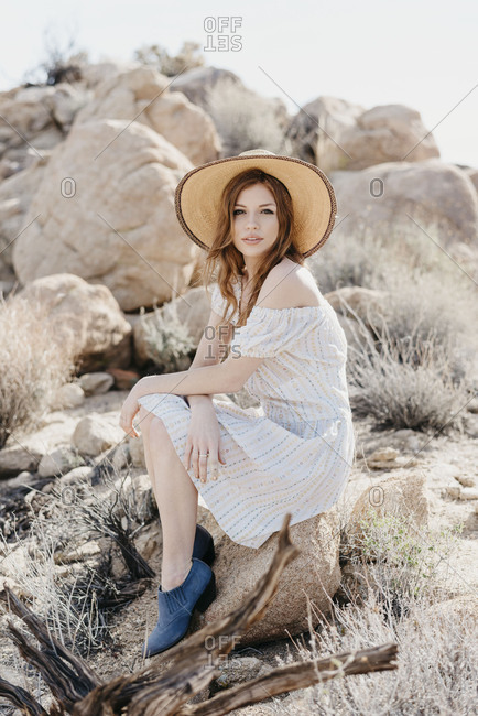 A portrait of a girl in the desert in blue shoes