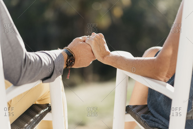 Middle Age Couple Holding Hands