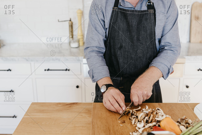Man Chopping in Modern Stylish Kitchen