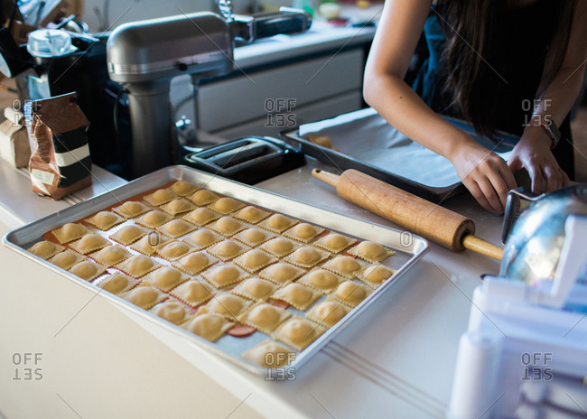 Woman making homemade ravioli in a kitchen