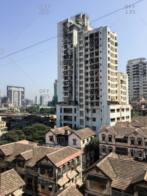 Mumbai, India - November 20, 2016: Residential buildings in the Nana Chowk neighborhood with skyscrapers in the distance