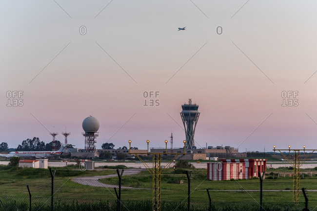 Industrial airfield and towers at sunset