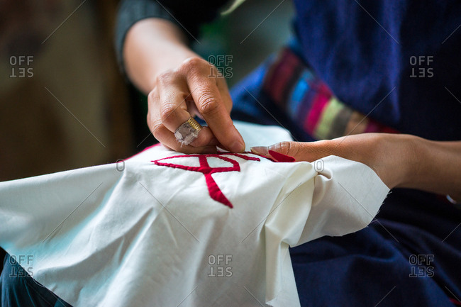 Woman sewing by hand