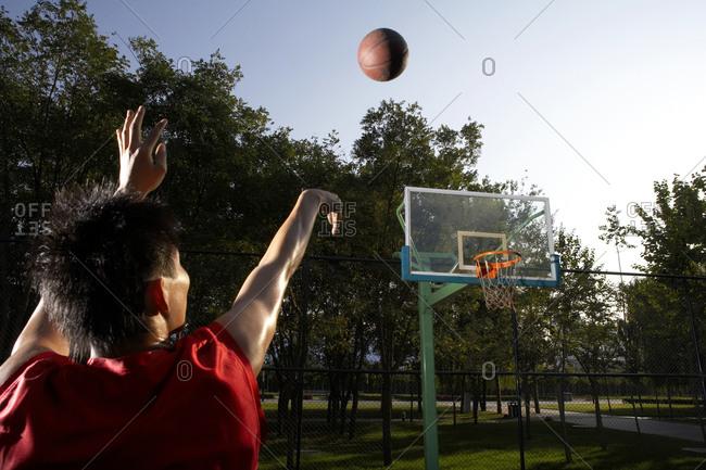 Basketball Player Shooting Hoops - Offset
