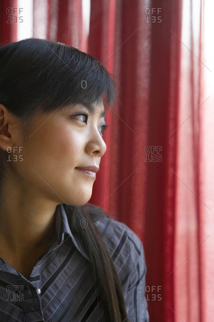 Woman Looking Out Of Window Contemplatively