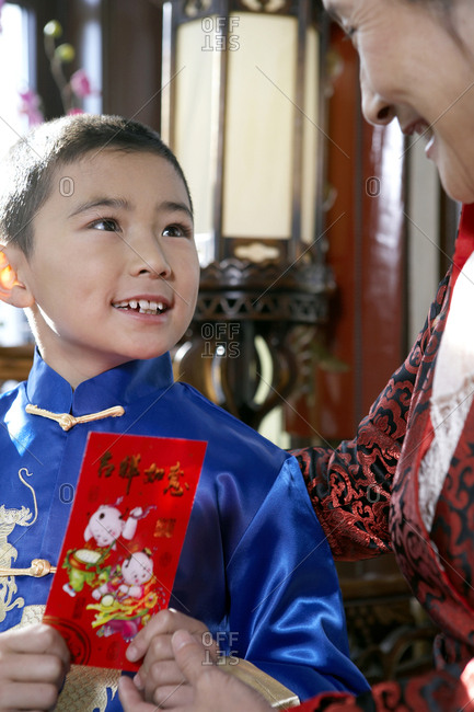 Boy And His Grandmother In Traditional Clothing