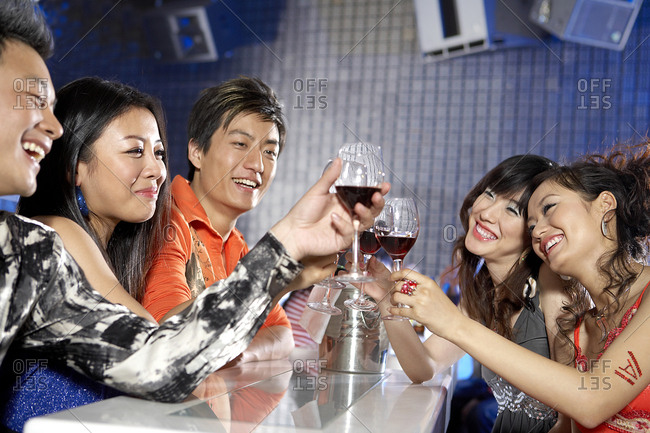 Group Of Friends In A Nightclub, Toasting