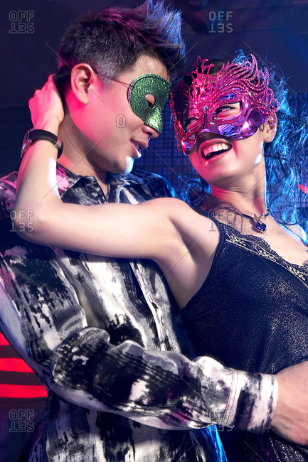 Young Couple In Costume Dancing In A Nightclub