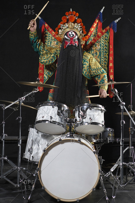 Man In Ceremonial Costume Playing The Drums