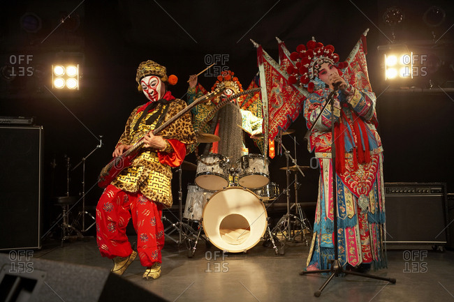 Band In Ceremonial Costume Playing Musical Instruments