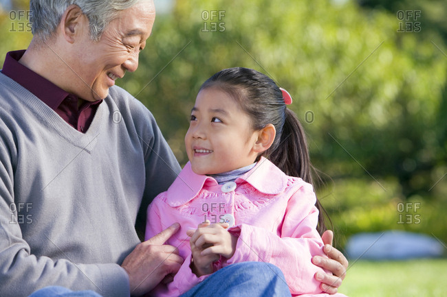 A grandfather and granddaughter share a special moment