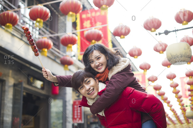 Young couple with candied haw berries celebrating Chinese New Year