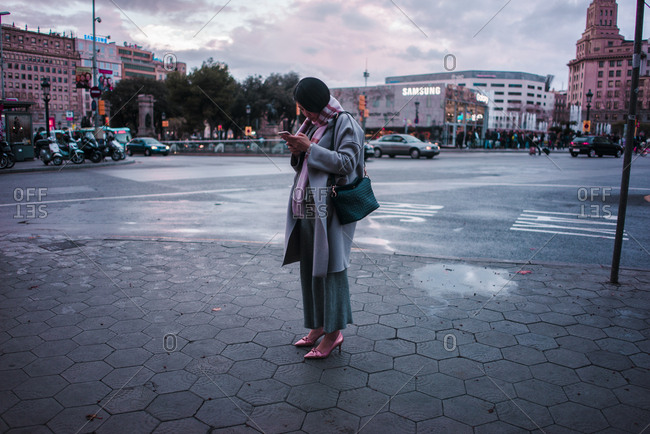 Barcelona, Spain - June 20, 2016: Woman looks at cellphone