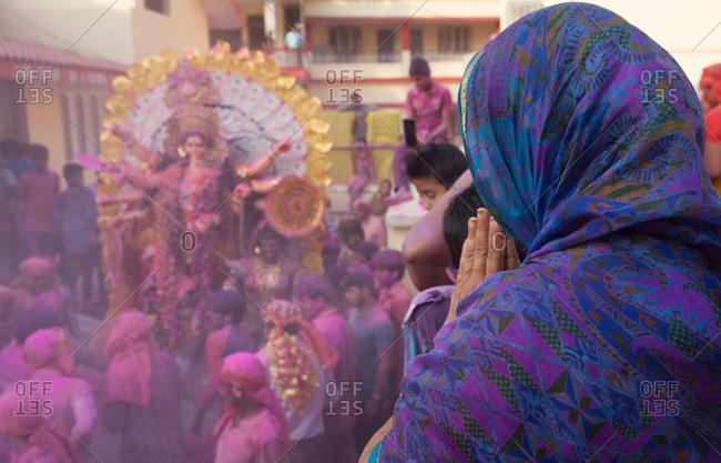 Rishikesh, India - October 23, 2015: A woman prays to Kali, an Hindu deity, during a festival in Rishikesh India