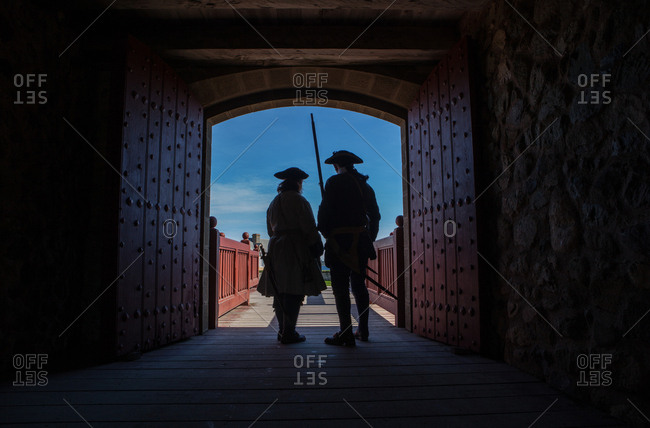 Living Museum with Two French soldiers guarding the front gate of the Louisburg Fortress in Nova Scotia, Canada