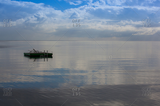 A floating dock in the middle of the ocean on a calm day